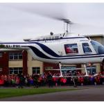 4 santa visits by helicopter